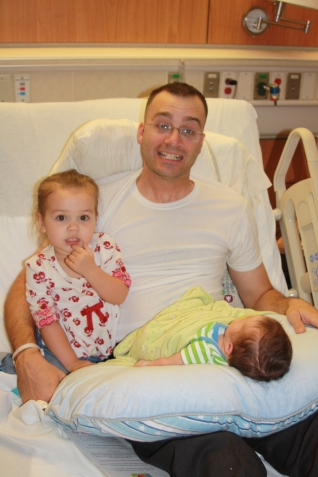 A super happy little Clare with her Daddy and baby brother.  She just couldn't get enough of him.